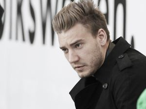 Bendtner dropped from Wolfsburg squad for turning up late to training