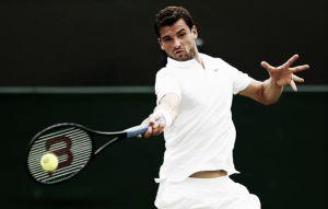 Dimitrov overcomes tough test to reach third round