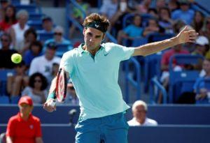 Federer impone su ley ante un meritorio Ferrer
