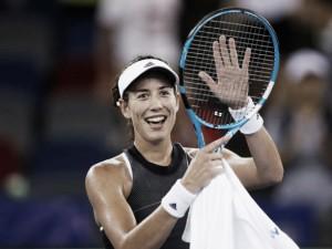WTA Wuhan: Garbiñe Muguruza sees off tricky Lesia Tsurenko