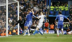 Chelsea leave it late to keep their top four hopes alive against Wigan.