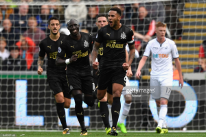 Swansea City 0-1 Newcastle United: Lascelles the star at both ends to hand Benítez-less Magpies victory