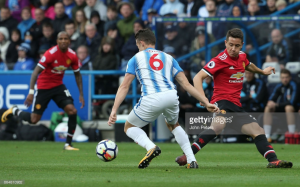 Jonathan Hogg says Huddersfield learned their lesson from harsh Spurs defeat to shock Manchester United