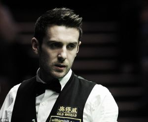 Selby overcomes Maflin rally to reach last sixteen