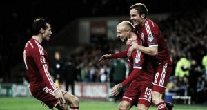 Wales 2-1 Cyprus: 10-man Dragons grind out win to stay top of Group B