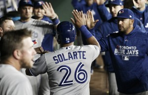 Blue Jays hold off late Rangers rally to win first road game of 2018