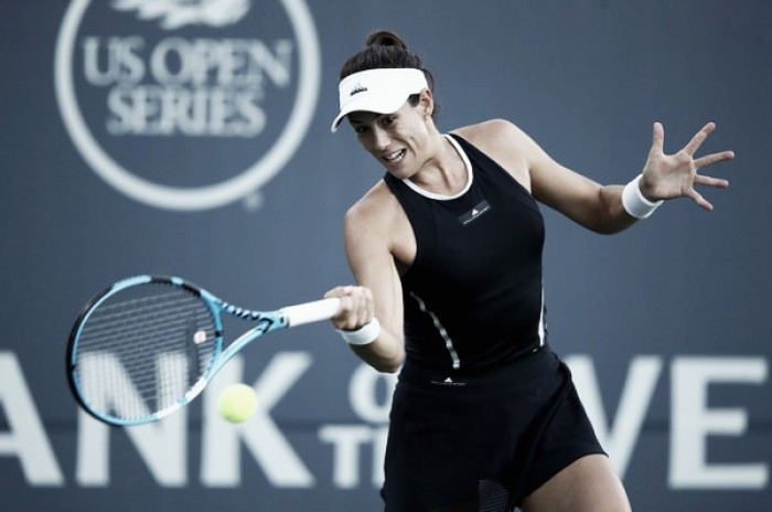 WTA Rogers Cup: Garbine Muguruza battles into round three