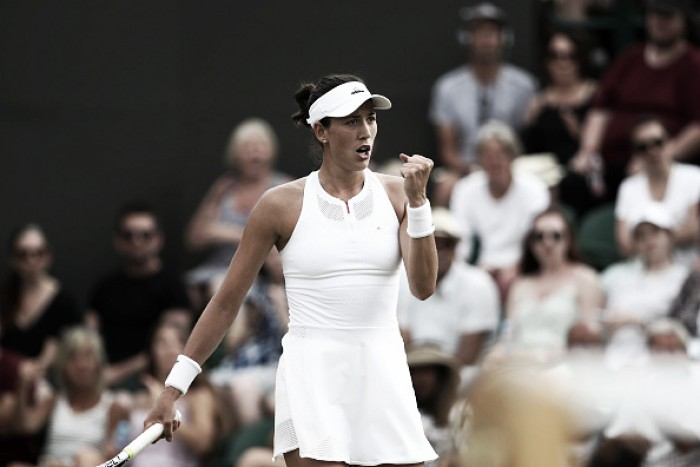 Wimbledon: Garbiñe Muguruza fends off Yanina Wickmayer in straight sets