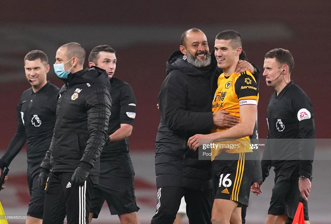 Conor Coady celebrates with his manager after picking up three points at the Emirates. (Photo by John Walton - Pool/Getty Images)
