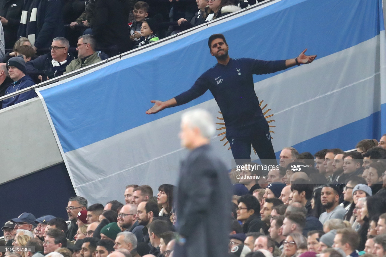 LONDON, ENGLAND - NOVEMBER 26: A flag for former Tottenham Hotspur manager Mauricio Pochettino is displayed in the crowd as Jose Mourinho, Manager of Tottenham Hotspur looks on during the UEFA Champions League group B match between Tottenham Hotspur and Olympiacos FC at Tottenham Hotspur Stadium on November 26, 2019 in London, United Kingdom. (Photo by Catherine Ivill/Getty Images)