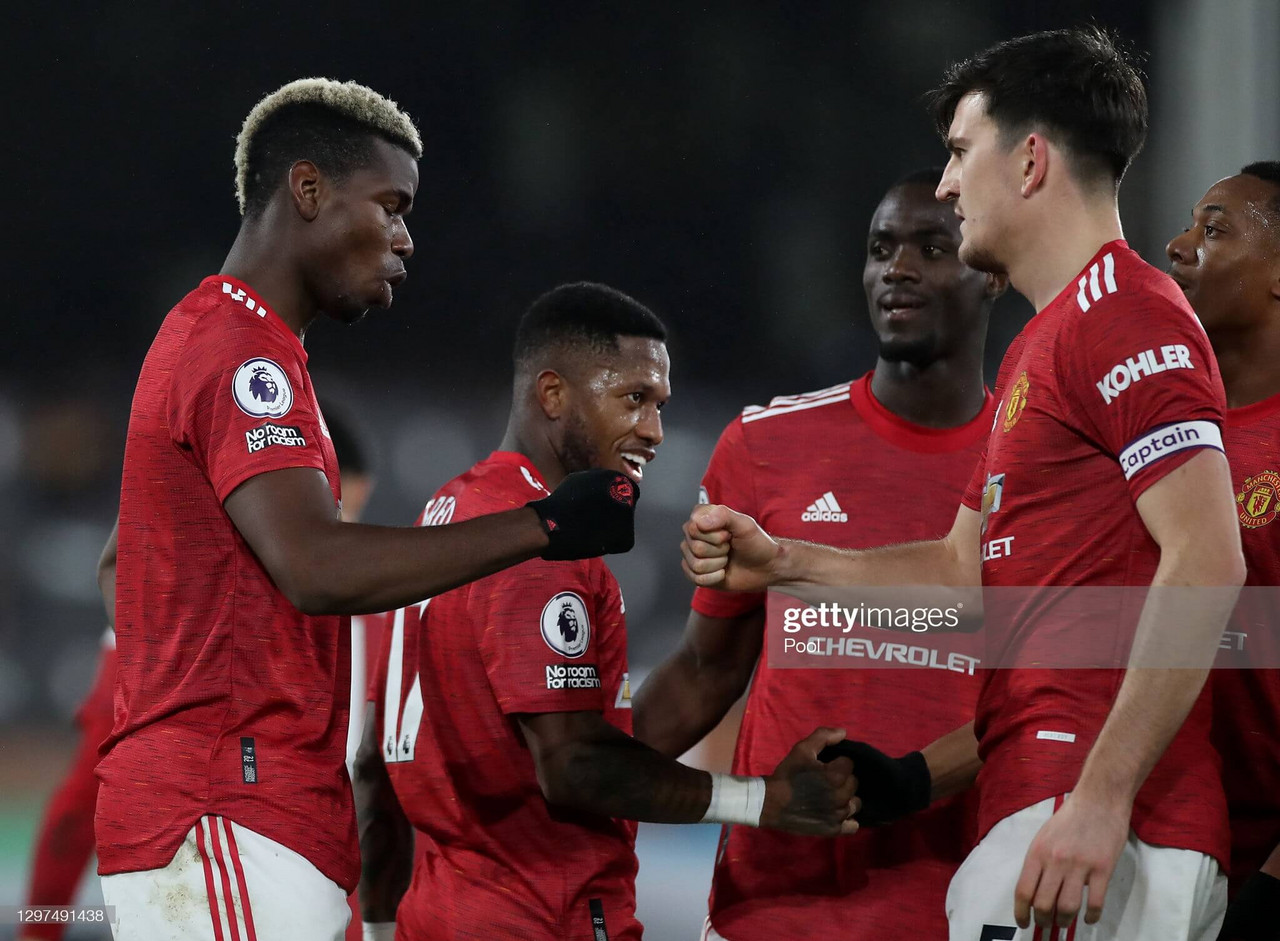 LONDON, ENGLAND - JANUARY 20: Paul Pogba of Manchester United celebrates with team mate Harry Maguire after scoring their side's second goal during the Premier League match between Fulham and Manchester United at Craven Cottage on January 20, 2021 in London, England. Sporting stadiums around the UK remain under strict restrictions due to the Coronavirus Pandemic as Government social distancing laws prohibit fans inside venues resulting in games being played behind closed doors. (Photo by Peter Cziborra - Pool/Getty Images)