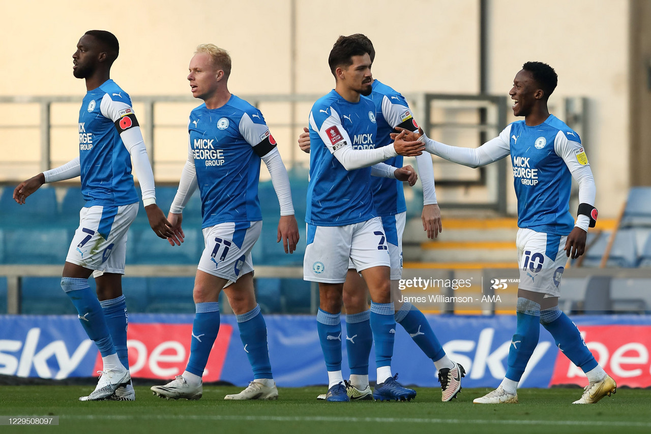 A familiar sight for Peterborough fans - Siriki Dembele celebrating a goal / Photo by James Williamson - AMA/Getty Images