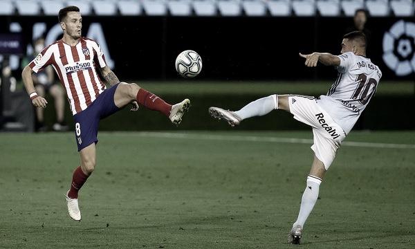 Iago Aspas y Saúl Ñíguez en una disputa de balón // Foto: atleticodemadrid.com