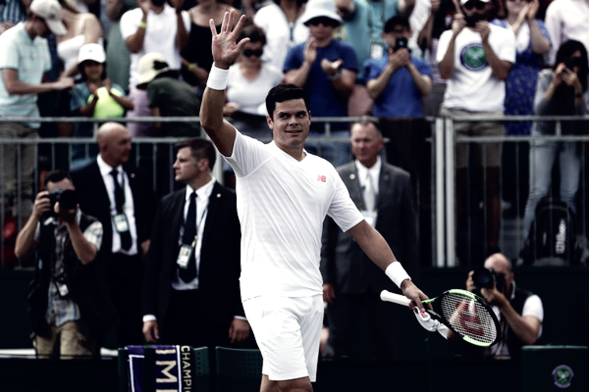 Wimbledon: Milos Raonic overcomes Dennis Novak, play suspension to advance