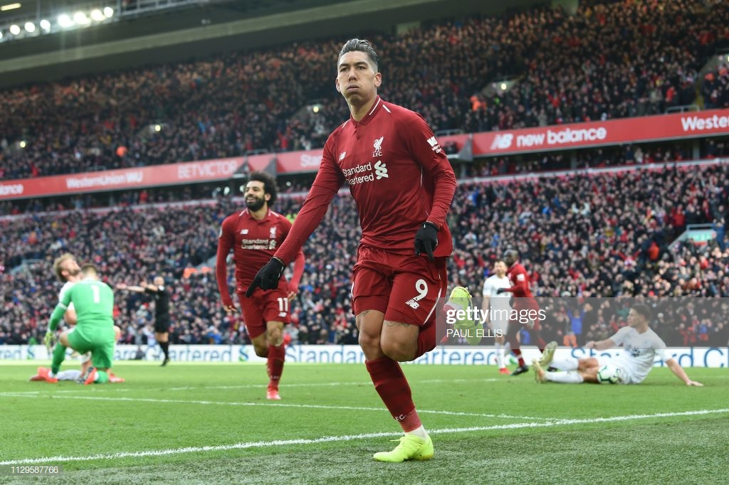 Liverpool 4-2 Burnley: Rampant Reds run riot to keep within a point of leaders City