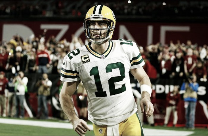 Aaron Rodgers carted off with shoulder injury after hard hit