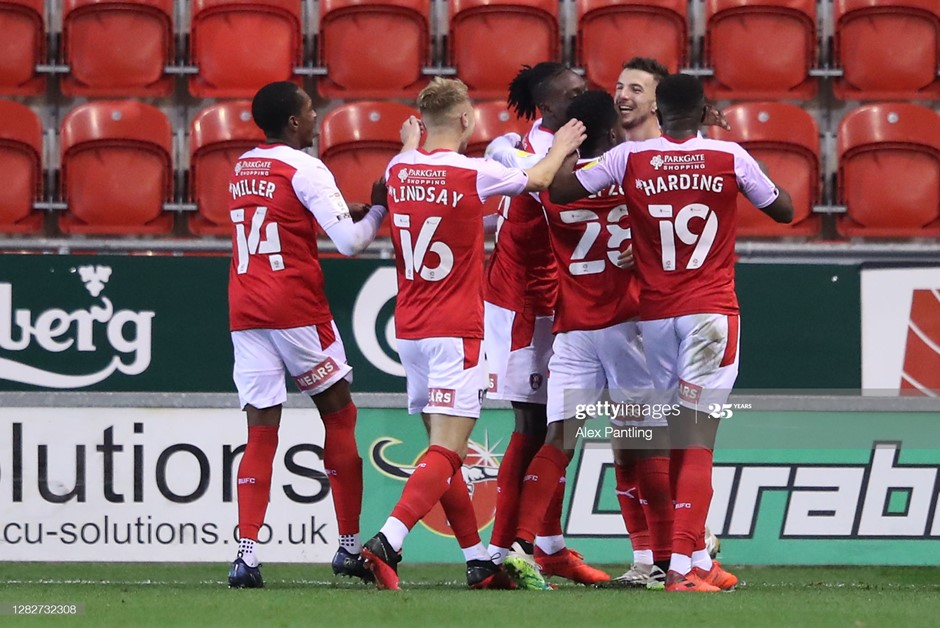 Rotherham United's players celebrate Dan Barlaser's first-half penalty against Sheffield Wednesday. Photo: Alex Pantling/Getty Images.
