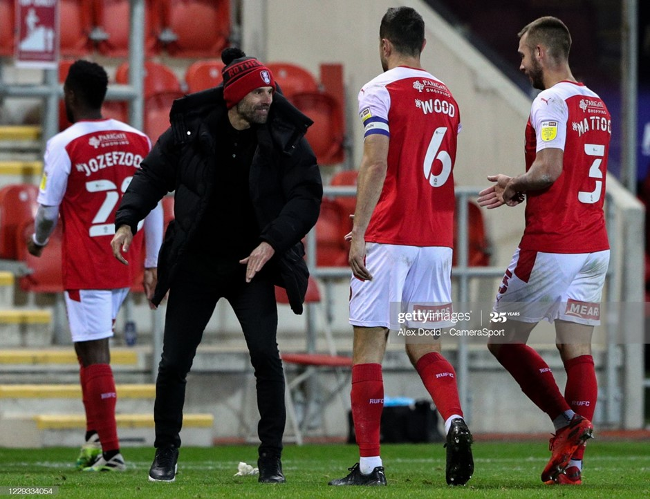 Paul Warne congratulates his Rotherham United players after their comfortable win over Sheffield Wednesday. Photo: Alex Dodd/CameraSport/Getty Images.