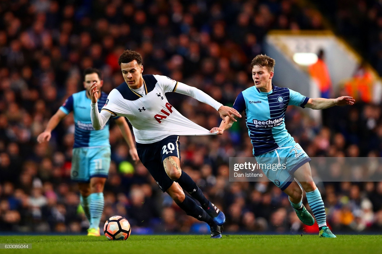LONDON, ENGLAND - JANUARY 28: Dele Alli of Tottenham Hotspur is pulled back by Dominic Gape of Wycombe Wanderers as he runs with the ball during the Emirates FA Cup Fourth Round match between Tottenham Hotspur and Wycombe Wanderers at White Hart Lane on January 28, 2017 in London, England. (Photo by Dan Istitene/Getty Images)