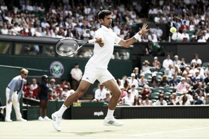 Wimbledon: Novak Djokovic through as Martin Klizan retires