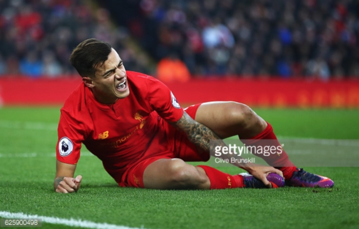 Liverpool face anxious wait over Philippe Coutinho ankle injury assessment