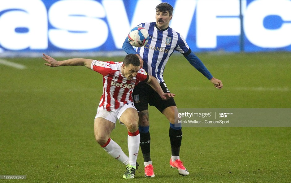 Stoke City's James Chester and Sheffield Wednesday's Callum Paterson battle for the ball. Photo: Mick Walker/CameraSport/Getty Images.
