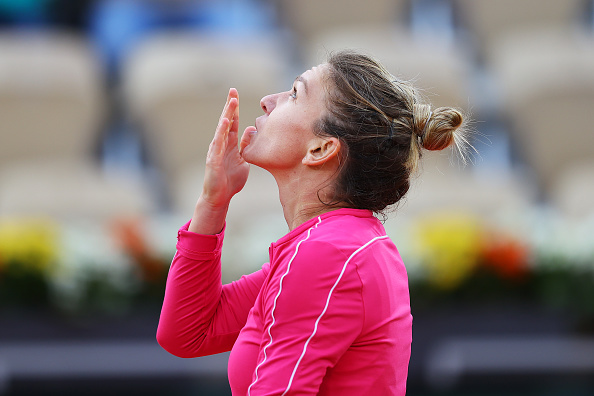 French Open: Simona Halep edges past compatriot Irina-Camelia Begu to reach the third round.