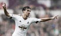 Swansea City 3-1 Liverpool: Ayew at the double as Swans secure safety in style
