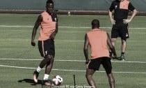 Divock Origi reveals he's 'fallen in love' with Liverpool, as the striker returns for pre-season training