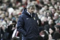 Pellegrini vows to keep Manchester City title challenge up