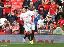 Rooney defends Paul Pogba after shaky start to second coming at Manchester United