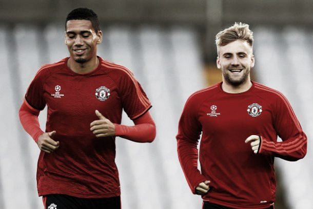 Luke Shaw with Chris Smalling for Manchester United