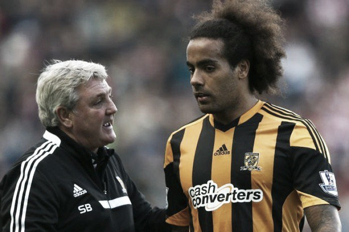 Steve Bruce to stay as Hull manager, whilst Huddlestone signs a new contract