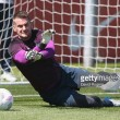 Tom Heaton returns home early after picking up a minor knock on international duty