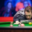 Judd Trump fights back to defeat Marco Fu and claim the Players Championship