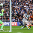 Bradford 0-1 Millwall: Morison slides home only goal as Lions earn promotion to the Championship