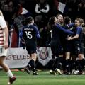 Midfielder Lindsey Horan (left) walks away as France celebrates a goal. | Associated Press