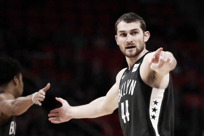 Milwaukee acquires Tyler Zeller from Nets for Rashad Vaughn, future 2nd-rounder