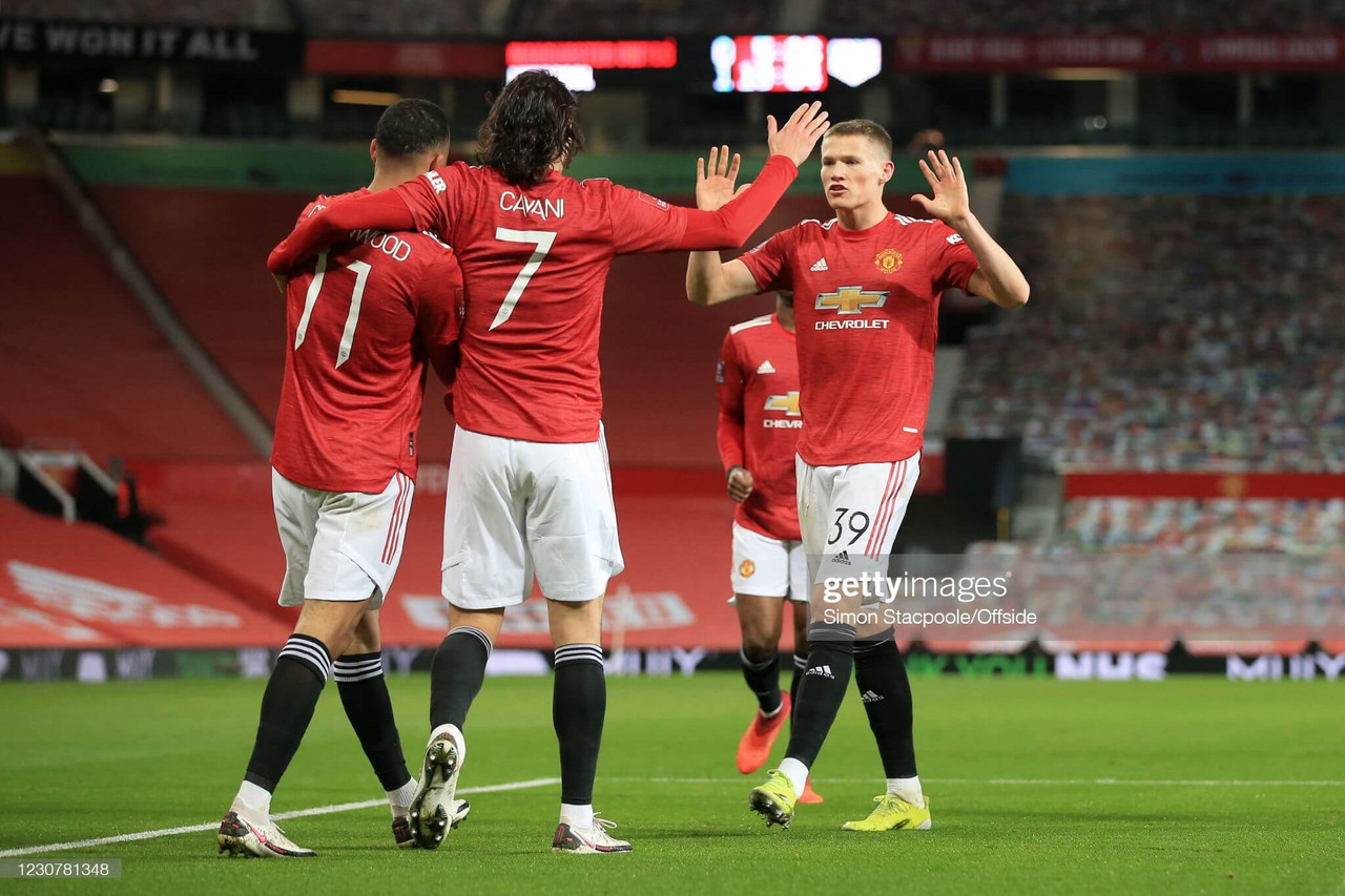 MANCHESTER, ENGLAND - JANUARY 24: Mason Greenwood of Manchester United (L) celebrates with teammates Edinson Cavani of Manchester United and Scott McTominay of Manchester United (R) after scoring their 1st goal during The Emirates FA Cup Fourth Round match between Manchester United and Liverpool at Old Trafford on January 24, 2021 in Manchester, England. Sporting stadiums around the UK remain under strict restrictions due to the Coronavirus Pandemic as Government social distancing laws prohibit fans inside venues resulting in games being played behind closed doors. (Photo by Simon Stacpoole/Offside/Offside via Getty Images)