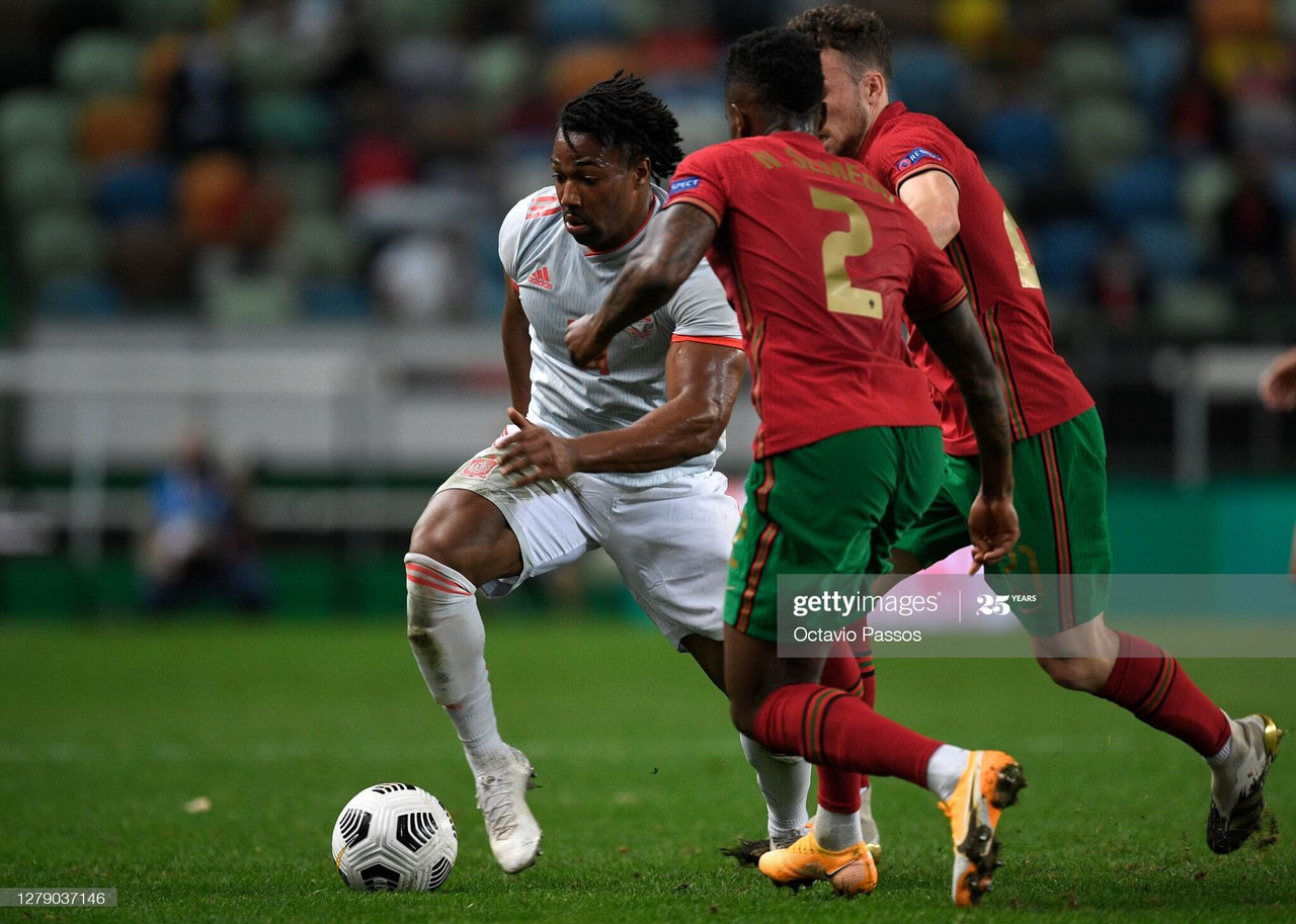 Traore under pressure from former Wolves team-mate Diogo Jota and current Wolves team-mate Nelson Semedo | Photo by Octavio Passos/Getty Images.