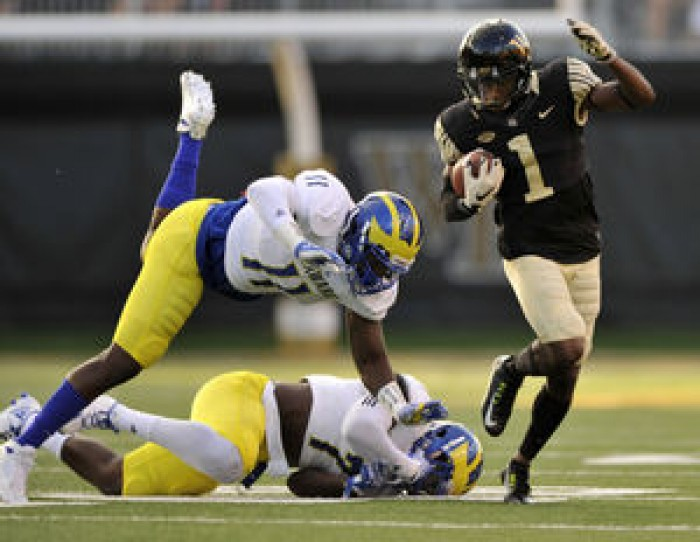 Wake Forest loses Hinton, but beats Delaware 38-21