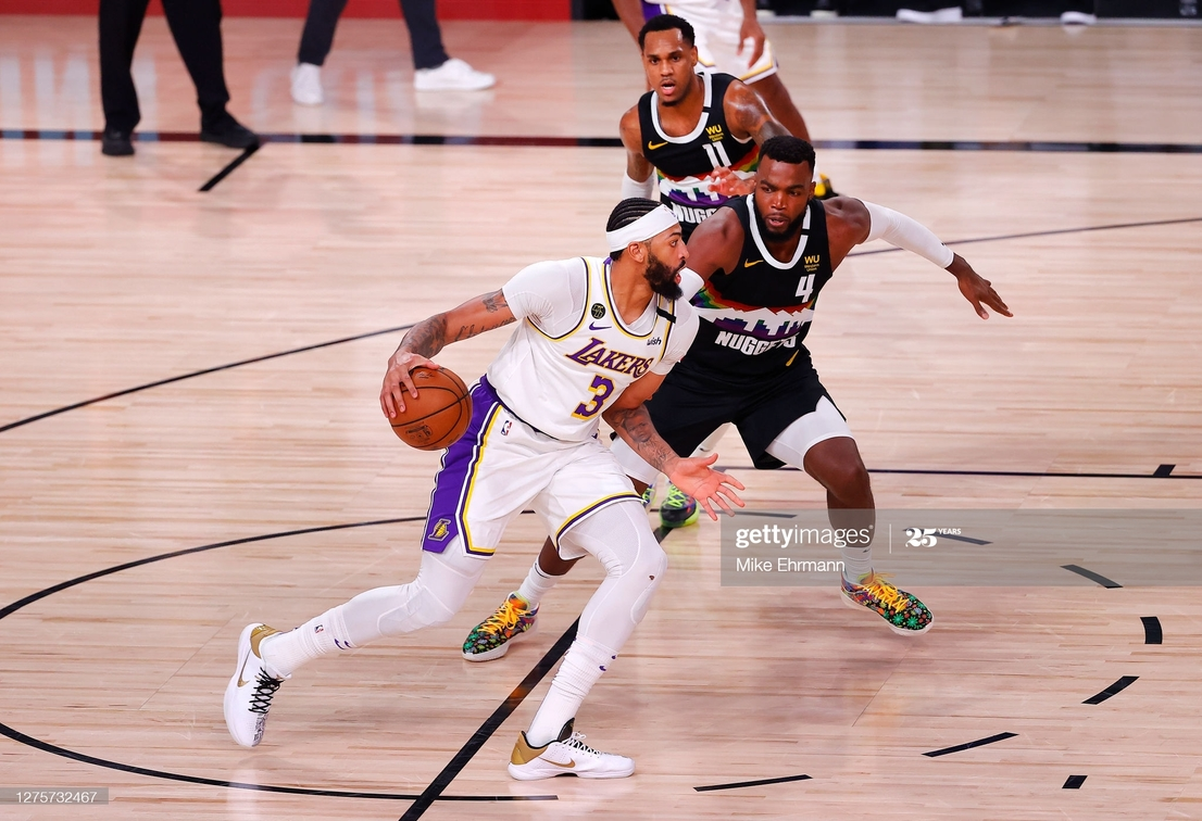 <div>LAKE BUENA VISTA, FLORIDA - SEPTEMBER 22: Anthony Davis #3 of the Los Angeles Lakers drives the ball against Paul Millsap #4 of the Denver Nuggets during the second quarter in Game Three of the Western Conference Finals during the 2020 NBA Playoffs at AdventHealth Arena at the ESPN Wide World Of Sports Complex on September 22, 2020 in Lake Buena Vista, Florida. NOTE TO USER: User expressly acknowledges and agrees that, by downloading and or using this photograph, User is consenting to the terms and conditions of the Getty Images License Agreement. (Photo by Mike Ehrmann/Getty Images)</div><div><br></div>
