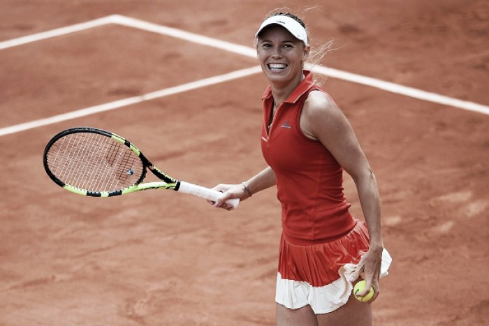 French Open: Caroline Wozniacki overcomes Svetlana Kuznetsova in three-set thriller to reach second quarterfinal in Paris