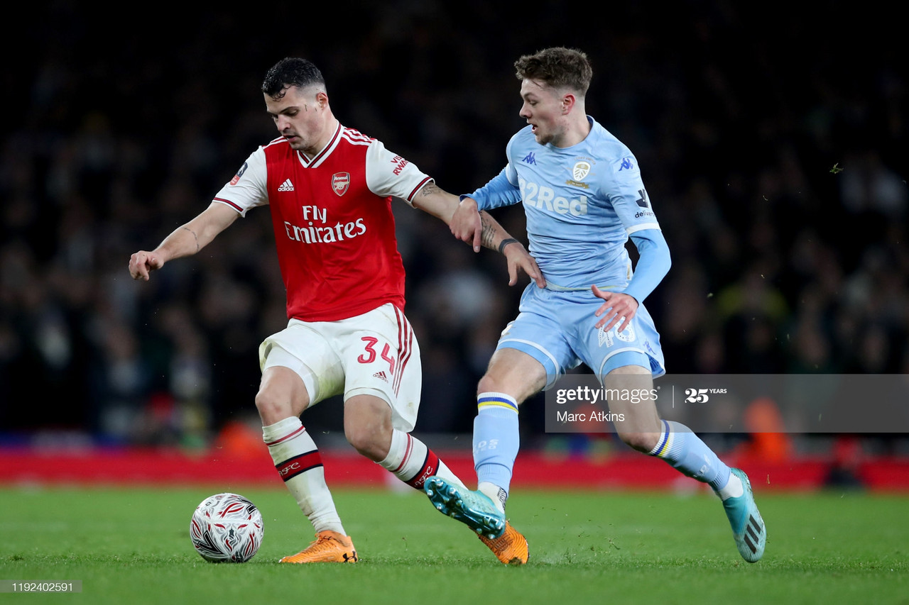 LONDON, ENGLAND - JANUARY 06: Granit Xhaka of Arsenal in action with Jordan Stevens of Leeds United during the FA Cup Third Round match between Arsenal and Leeds United at Emirates Stadium on January 6, 2020 in London, England. (Photo by Marc Atkins/Getty Images)